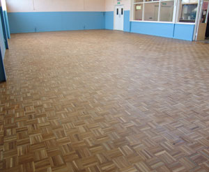 Finished wooden floor in a church hall