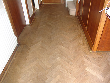 Sanding herringbone floorboards