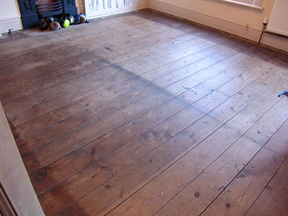 Sanding pine floorboards